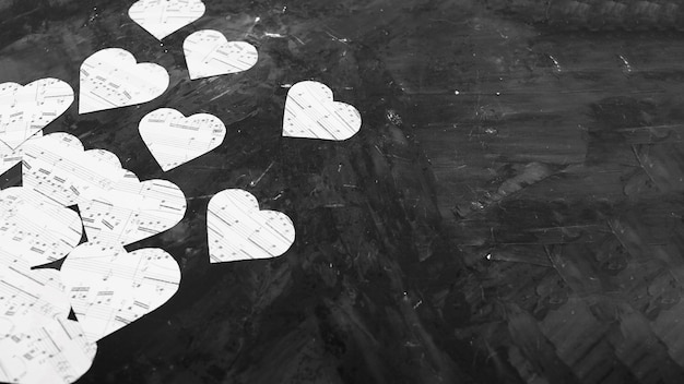 Music notes on heart shaped paper Free Photo
