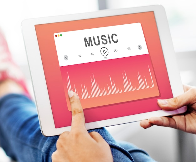 Music player application showing on a digital tablet Premium Photo