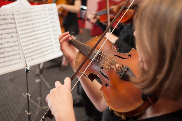 Music school for girls on the violin Premium Photo