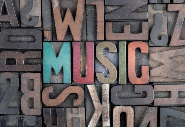 Music word in letterpress printing blocks Premium Photo