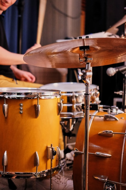 Musical instruments on stage, ready for the gig, drum set on stage Premium Photo