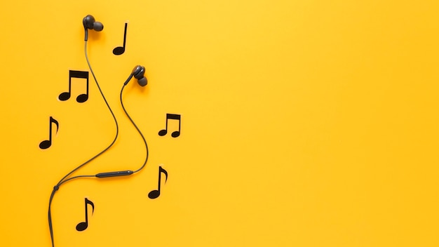 Musical notes and earphones with copy space Premium Photo