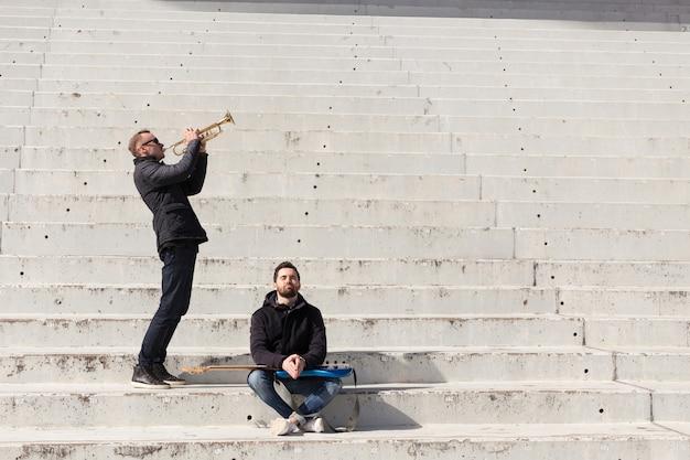 Musician friends in a stadium Free Photo