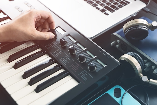 Musician is adjusting sound on synthesizer keyboard Photo