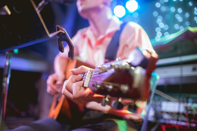 Musician playing guitar at a party Premium Photo