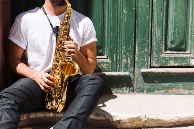 Musician playing the sax in the street Free Photo