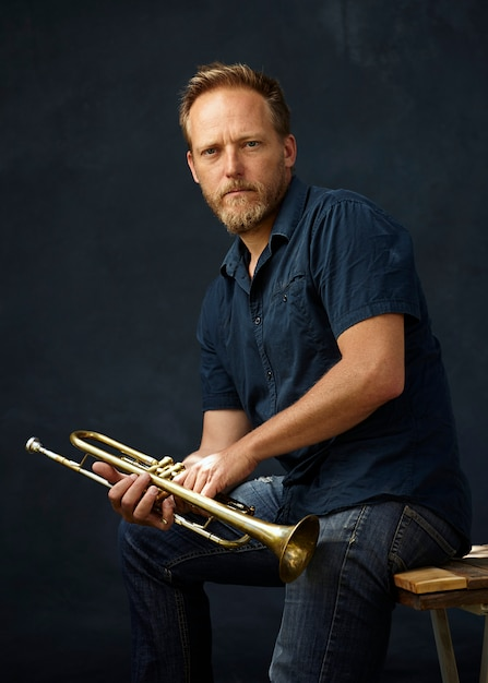 Musician posing with his instrument Free Photo