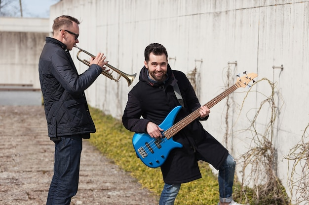 Musicians playing outside Free Photo