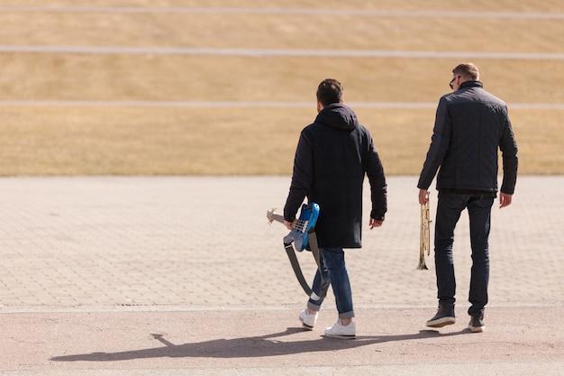 Musicians walking Free Photo