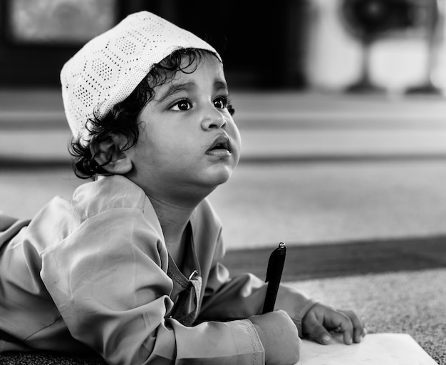 Muslim boy learning in a mosque Free Photo