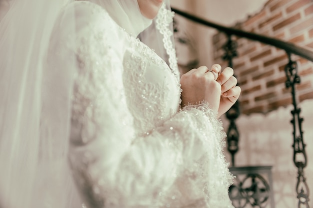 The muslim bride touching her ring on finger Premium Photo