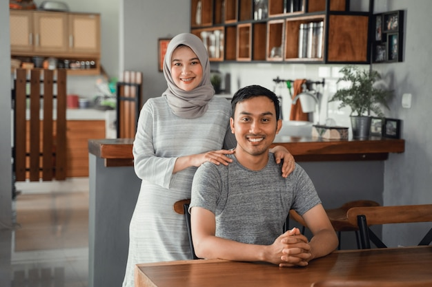 Muslim couple sitting in dining room together Premium Photo
