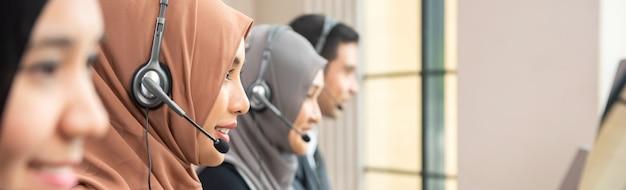 Muslim customer service operator team working in call center office Premium Photo
