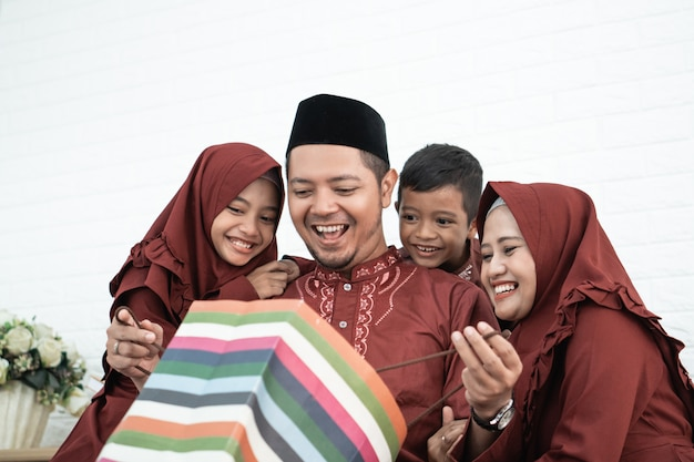 Muslim father opened a surprise of paper bags Premium Photo