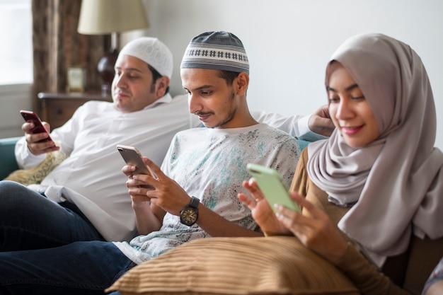 Muslim friends using social media on phones Premium Photo