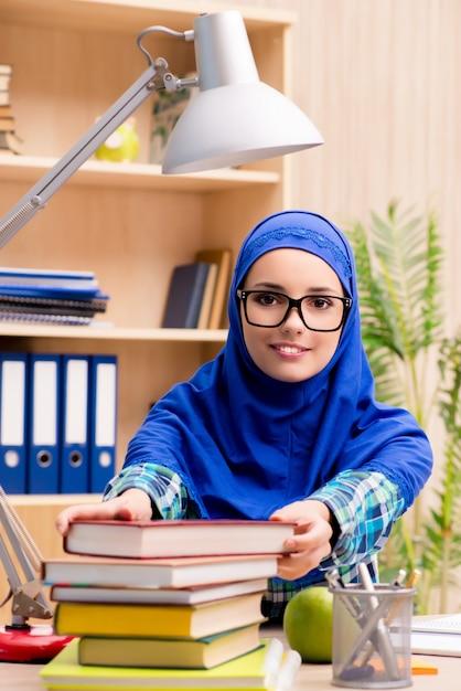 Muslim girl preparing for entry exams Premium Photo