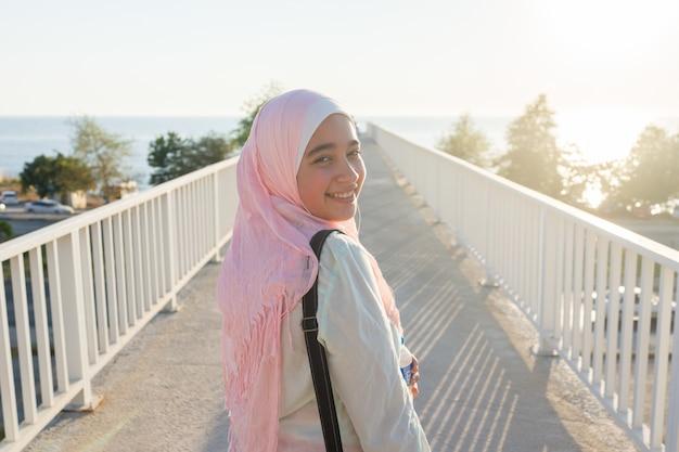 Muslim girl on sea coast Premium Photo
