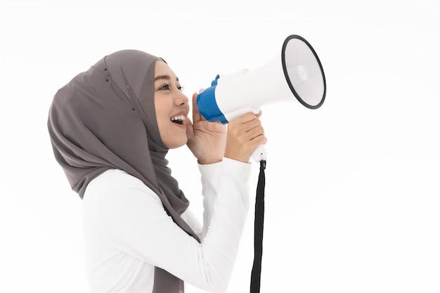 Muslim girl with megaphone Premium Photo