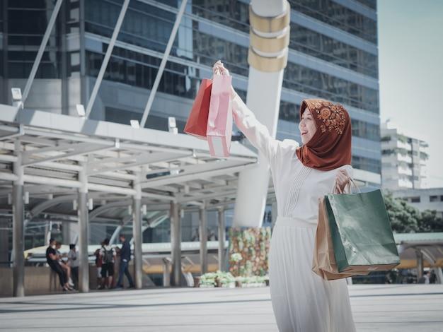 Muslim girl with shopping bag Premium Photo