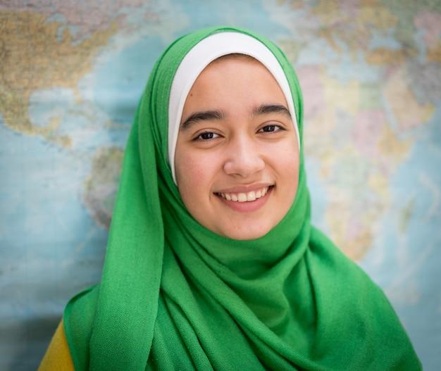 Muslim girl with world map Premium Photo