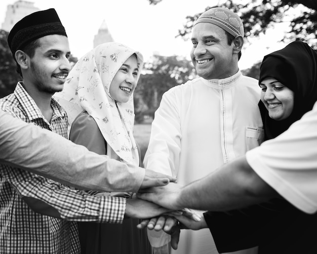 Muslim group of friends stacking hands Free Photo