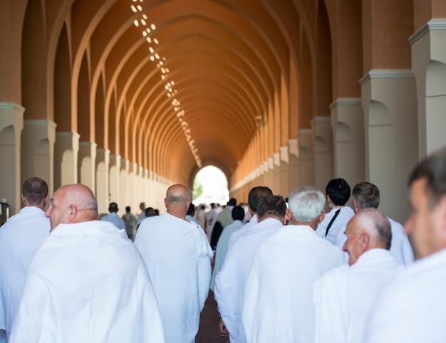 Muslim man enjoying his visit to holy mosque Premium Photo