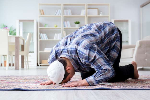 Premium Photo | Muslim man praying at home