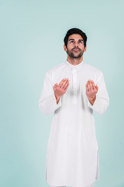 Muslim man praying Free Photo