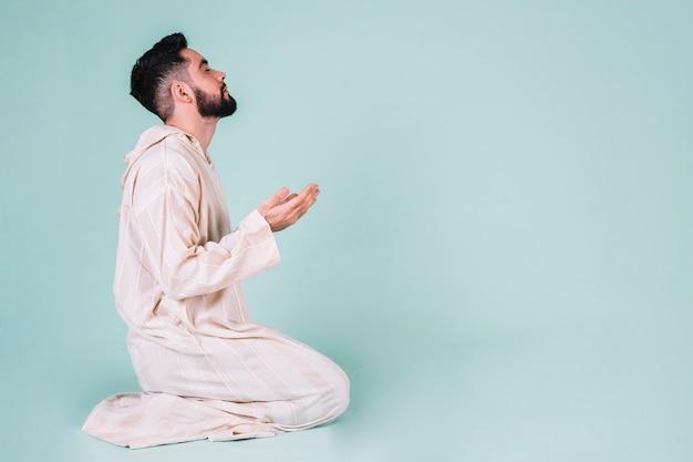 Muslim man praying Free Photo