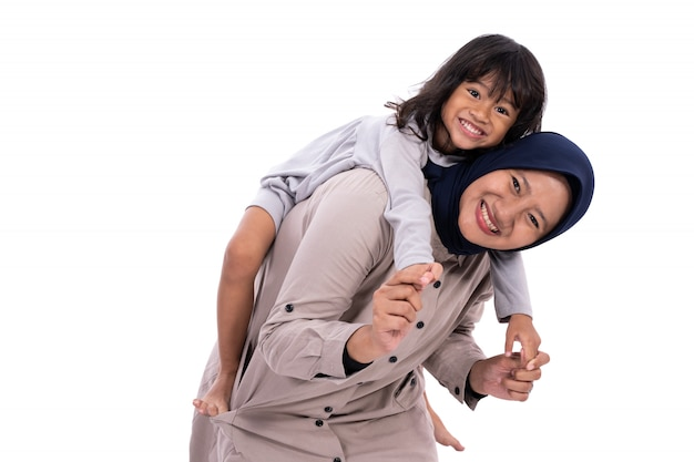 Muslim mother and her daughter isolated Premium Photo