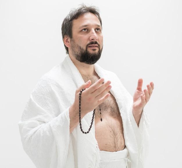 Muslim pilgrim with hajj clothes Premium Photo