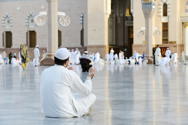 Muslim prayer at holy mosque Premium Photo