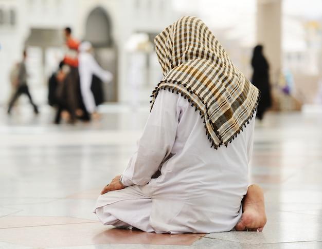 Muslim praying at medina mosque Premium Photo