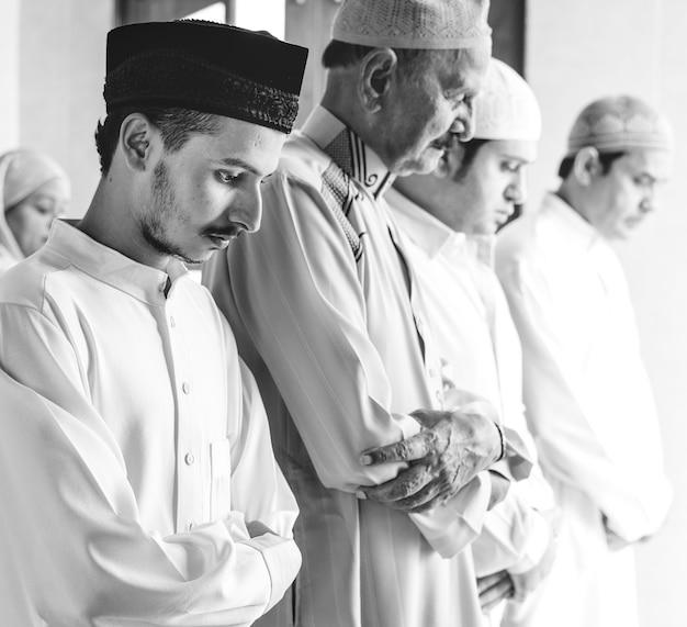 Muslim praying in qiyaam posture Free Photo
