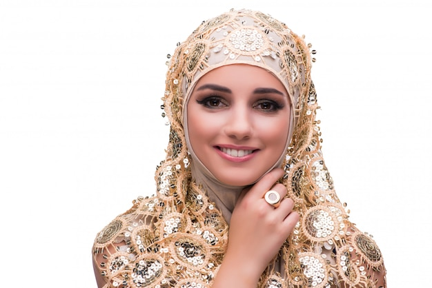Muslim woman in gold cover isolated Premium Photo