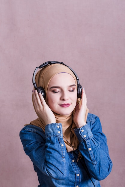 Beautiful woman listening to music with earphones | Free Photo |Woman Listening To Music