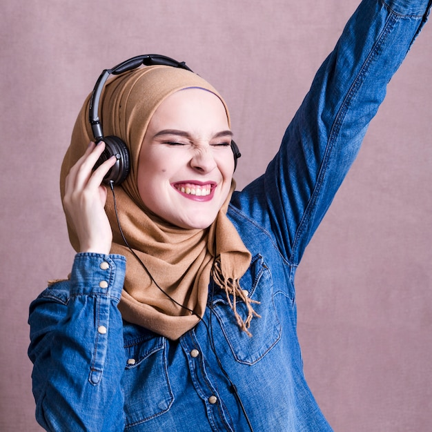 Young woman listening music on headphone | Free Photo |Woman Listening To Music