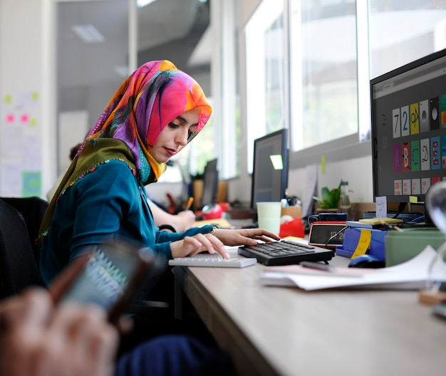 Muslim woman working at the office Free Photo