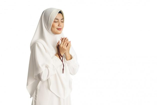 Muslim young woman praying open her arm Premium Photo