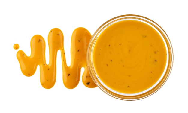 Mustard sauce in bowl isolated on white background Premium Photo