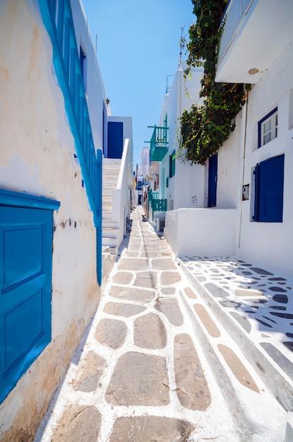 Mykonos, greece. whitewashed dotted alley in old city, greek islands. Premium Photo