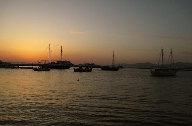 Mykonos old port under the beautiful sunset sky, mykonos island, greece Premium Photo