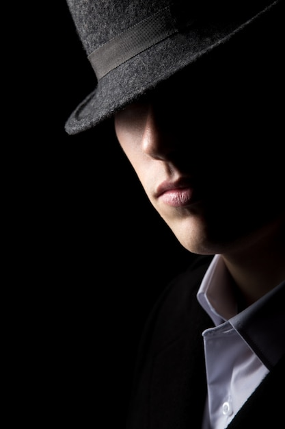 Mysterious man in hat Free Photo