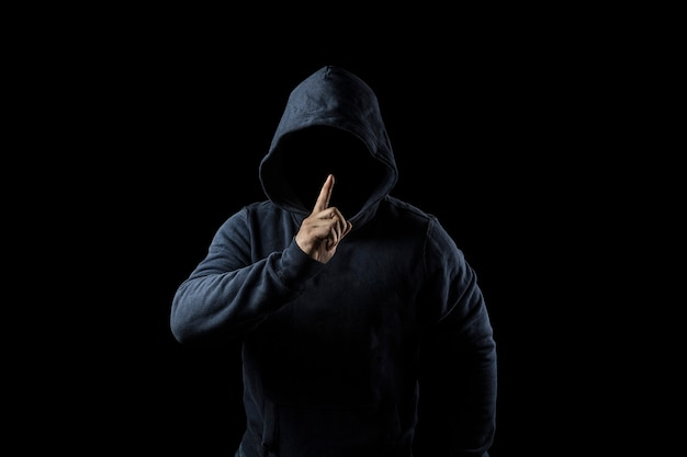Mysterious, unknown person in the hood. danger in darkness. anonymous or criminal concept Premium Photo