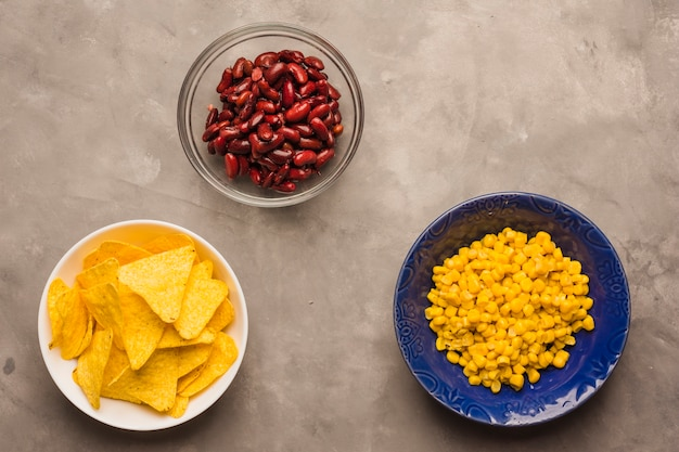 Nacho chips, beans and corn Free Photo