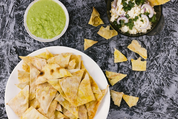 Nachos and guacamole dip on marble background Free Photo