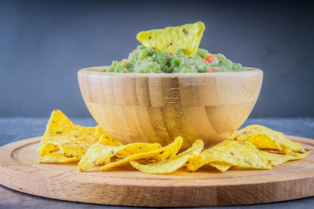 Nachos with guacamole on a gray background Premium Photo