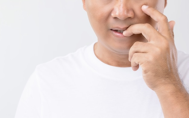 Nail biting (onychophagia) concept : portrait people biting his nail. Premium Photo