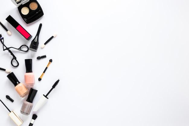 Nail polish with cosmetics on table Free Photo