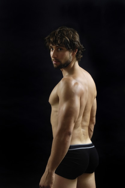 Naked man showing his body fitness Premium Photo